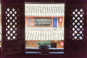 Flower Mirage Inn, Privatzimmer  Lijiang - big - 56