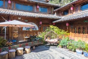 Flower Mirage Inn, Privatzimmer  Lijiang - big - 57