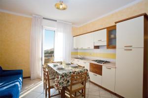 Pia del Faro, Апартаменты/квартиры  Бибионе - big - 4