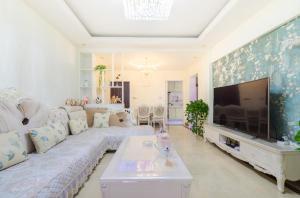 Flowers & Fruits Three-Bedroom Apartment, Apartmány  Kuej-jang - big - 19