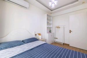 Flowers & Fruits Three-Bedroom Apartment, Apartmány  Kuej-jang - big - 22