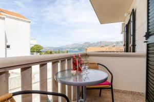 apartments & rooms cina - basic studio apartment with balcony and sea view (a...