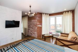 Loft Apartment on Pervomayskaya 50 - Tyumen
