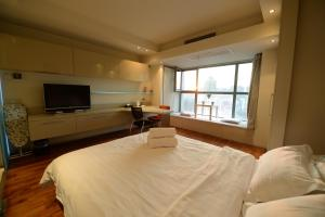 Beijing New Oriental Suites in Seasons Park Sanlitun, Residence  Pechino - big - 49