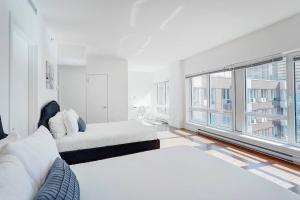 Palais-des-Congrès Furnished Apartments by Hometrotting, Apartmány  Montreal - big - 32
