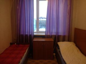 Номер (Односпальная кровать в общем номере для женщин)