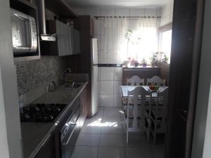 Residencial Leal, Case vacanze  Florianópolis - big - 15