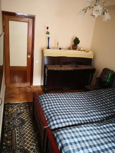 Apartment Erekle, Privatzimmer  Bordschomi - big - 15