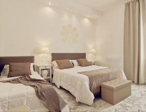 FLOS Guest House - AbcAlberghi.com