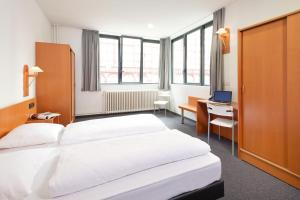 emblème de l'établissement Century Hotel Antwerpen Centrum