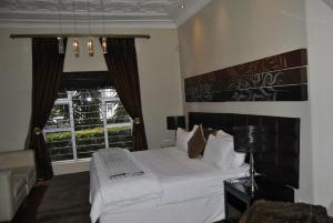 Saffron Guest House, Penziony  Johannesburg - big - 63