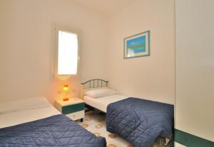Villa Trimotel, Appartamenti  Bibione - big - 9