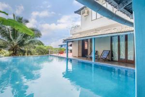 Riverside pool villa in Alto de Porvorim, Goa, by GuestHouser 65646, Vily  Macasana - big - 13