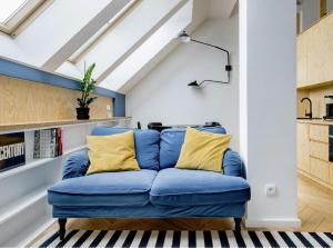 Hip Loft Apartment with Skylight Windows