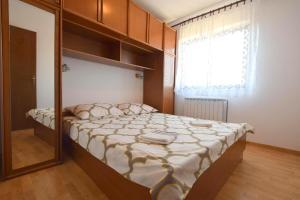 Apartments Petrica, Апартаменты  Малинска - big - 14