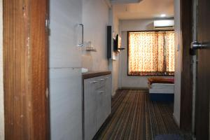 Deluxe Double Room Ganesh Banquet And Hotel