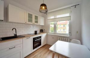 ApartInvest Apartament Pastelowy