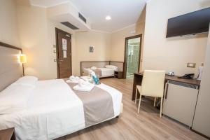 Chambre Triple Confort avec Terrasse - Rez-de-Chaussée
