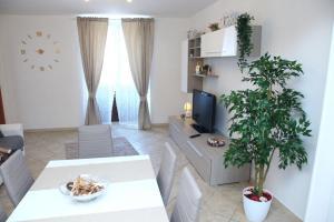 Garibaldi Suites & Apartments - AbcAlberghi.com