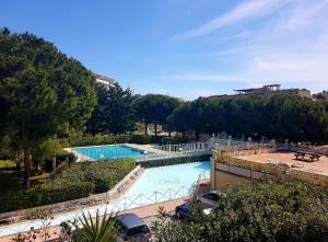 obrázek - Studio, piscine, parking, accès mer en 2min à pied.