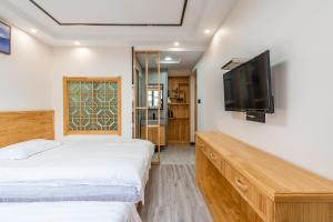 Cihang Chan Apartment, Ferienwohnungen  Zhoushan - big - 4