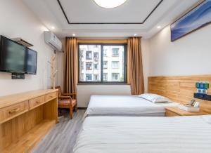 Cihang Chan Apartment, Ferienwohnungen  Zhoushan - big - 33