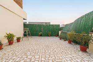 Room in a BnB in Gurgaon, by GuestHouser 8267, Holiday homes  Gurgaon - big - 16