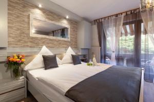 Hotel Petra - Brunnenteich