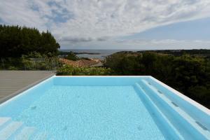 CanguroProperties - Villa Karigal - AbcAlberghi.com
