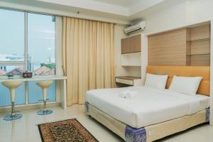 Modern Studio Ancol Mansion Town Home Apartment By Travelio
