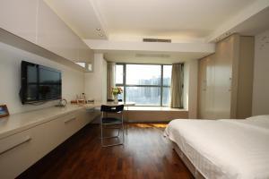 Rich&Young Seasons Park Service Apartment, Ferienwohnungen  Peking - big - 2