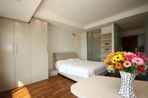 Rich&Young Seasons Park Service Apartment, Ferienwohnungen  Peking - big - 3