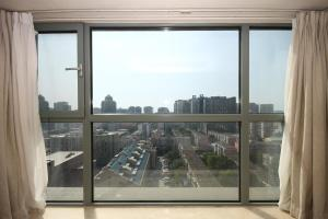 Rich&Young Seasons Park Service Apartment, Ferienwohnungen  Peking - big - 7