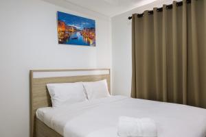 obrázek - Elegant Studio Apartment at Springwood Residence By Travelio