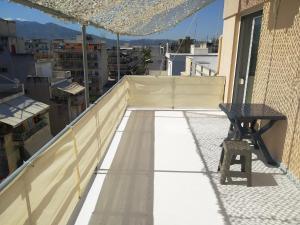 rooftop studio near port and center WiFi/crib Achaia Greece