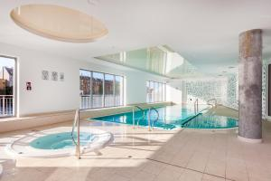 Frey Homes Suite Waterline with amazing pool and gym