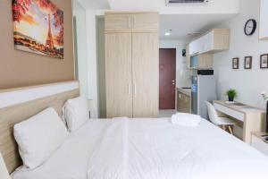 obrázek - Cozy Studio Apartment @ Springwood Residence By Travelio