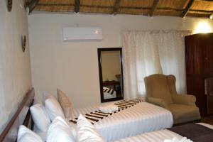 Chobe Sunset Chalets, Affittacamere  Lesoma - big - 7