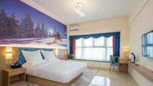 obrázek - Floral Hotel Bingxue Qiyu Theme Apartment