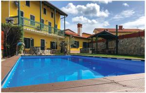 Four-Bedroom Holiday Home in Komen