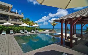 Bon Azur Beachfront Suites & P..