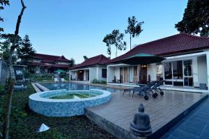 Villa Kendi, Комплексы для отдыха с коттеджами/бунгало  Kalibaru - big - 19