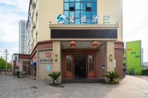 . Suoxing Hotel (Dazu Sheke Xincheng)