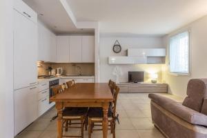 Anna Grassetti - The Place Apartments - AbcAlberghi.com