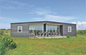Four-Bedroom Holiday Home in R..