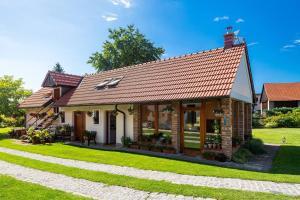 Tradiční český dům s ložnicemi v podkroví