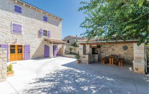 Awesome home in Burici w/ WiFi and 4 Bedrooms