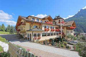 Family Hotel La Grotta - Campitello di Fassa