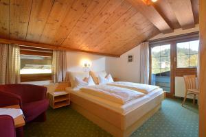 Pension Hinterholzer - Hotel - Scheffau am Wilden Kaiser