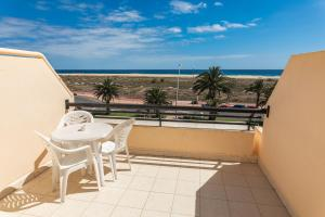 Palm Garden with sea views to the beach, pools